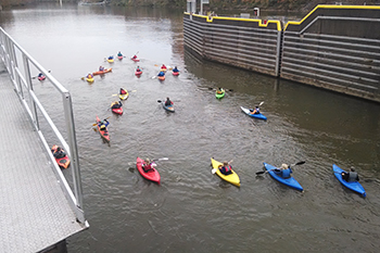 Kayaks exiting a lock