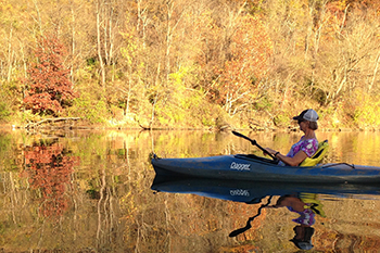 One Canoe on River during Fall